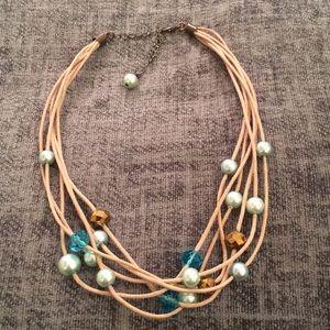 Jewelry - Six strand choker beige cord w light blue pearls